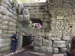 Our tour guide, Matilda, at the first gate of the fortress at Butrint.